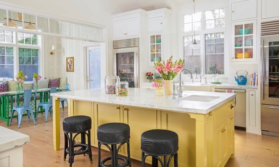 A fun warm contemporary bright kitchen…a lovely warm family kitchen.  Via