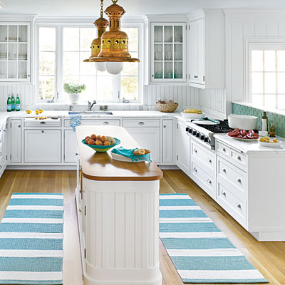 If you have a beach house, this darling coastal kitchen might be the perfect inspiration for a much needed kitchen renovation.  via