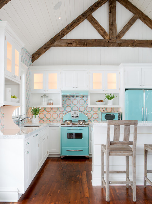 A crisp white kitchen with vintage-new appliances in aqua adds a splash of coastal vibe, and the pretty backsplash is so beachpretty!  Via