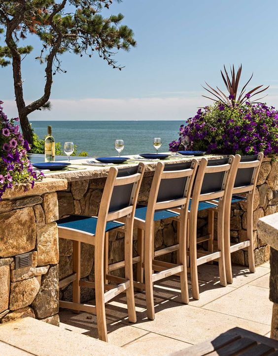 A custom-designed outdoor stone dining island..so beach pretty! Wish list for sure. :) View more beautiful ideas at Beach Pretty.