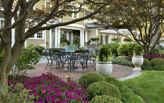 Hiring a landscape designer can make your create a beautiful yard year-round...I love beautiful perennial gardens and cobblestone paths. don't you?