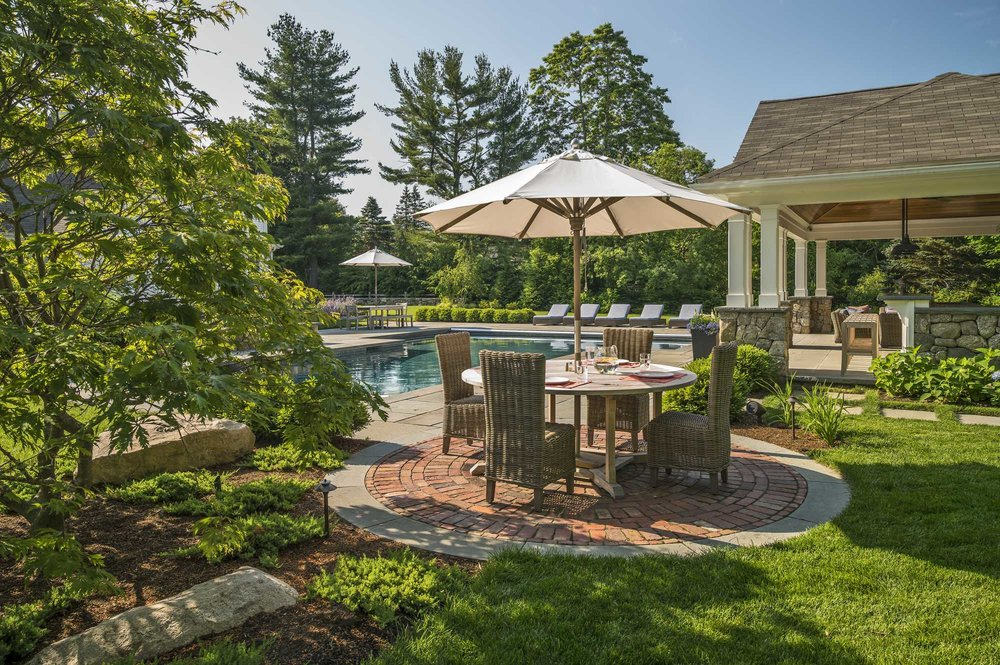 It is all in the perfectly planned details, I love the brick circle under the patio table…what a beautiful backyard.