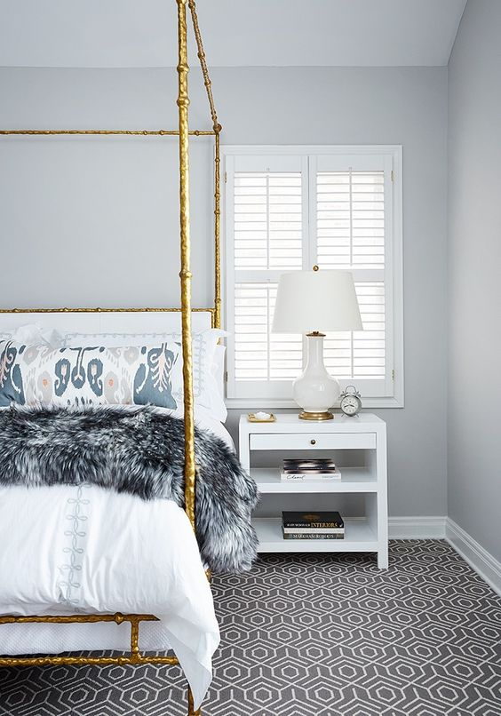 How pretty is this canopy bed? The showpiece of the room is the gold iron canopy bed…so pretty for the women that likes to spice things up.  via