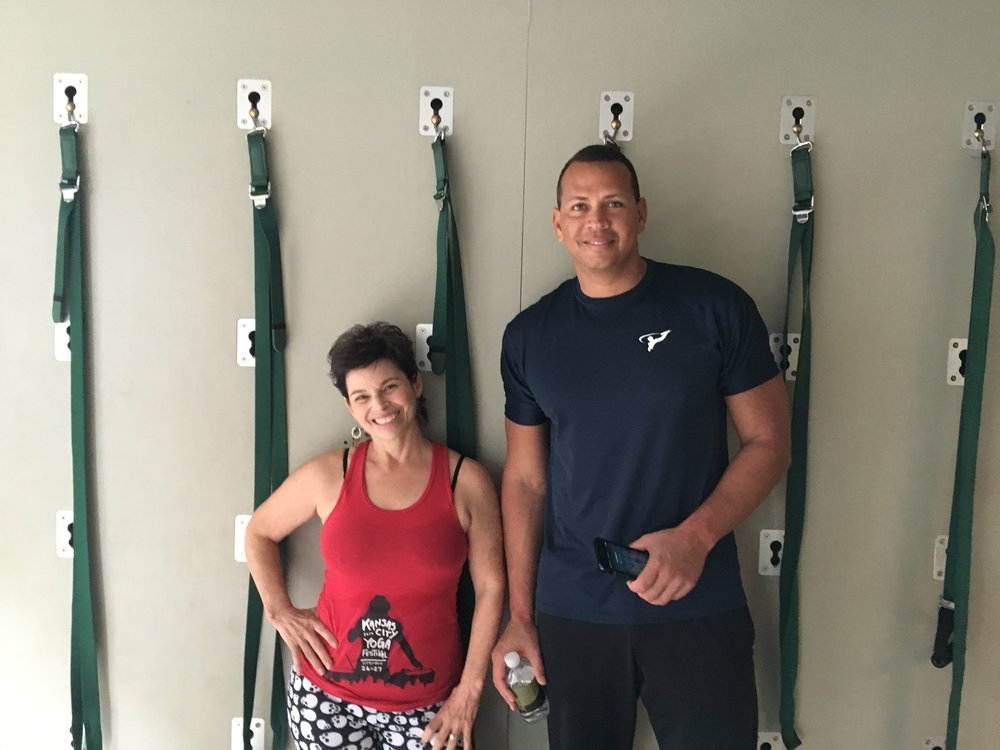 KELLY COLLN AND A SPECIAL GUEST HANGING OUT ON THE YOGA WALL . HE HAD NEVER WORKED WITH ONE BEFORE AND HE WAS IMPRESSED!