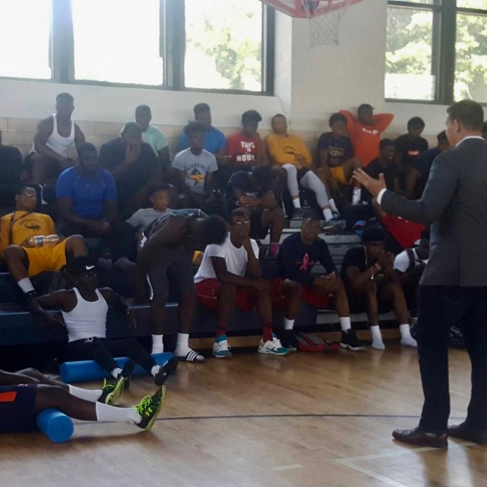 "Spencer Coursen of Coursen Security Group discusses the importance of protecting your personal brand to student athletes who are part of the ""Men of Code"" program at Friendship Collegiate Academy  in Washington, D.C."