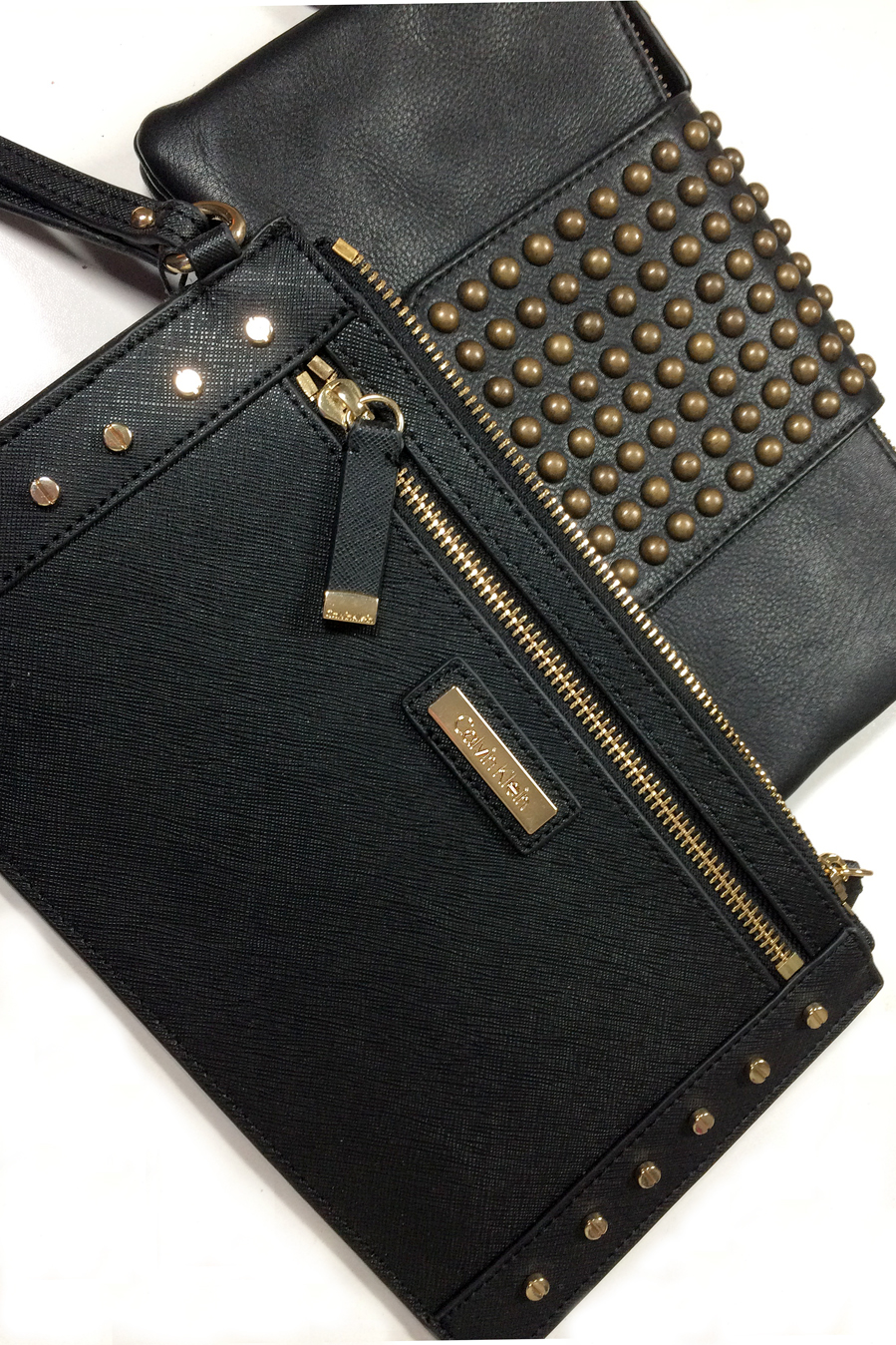 Calvin Klein, True Religion clutch