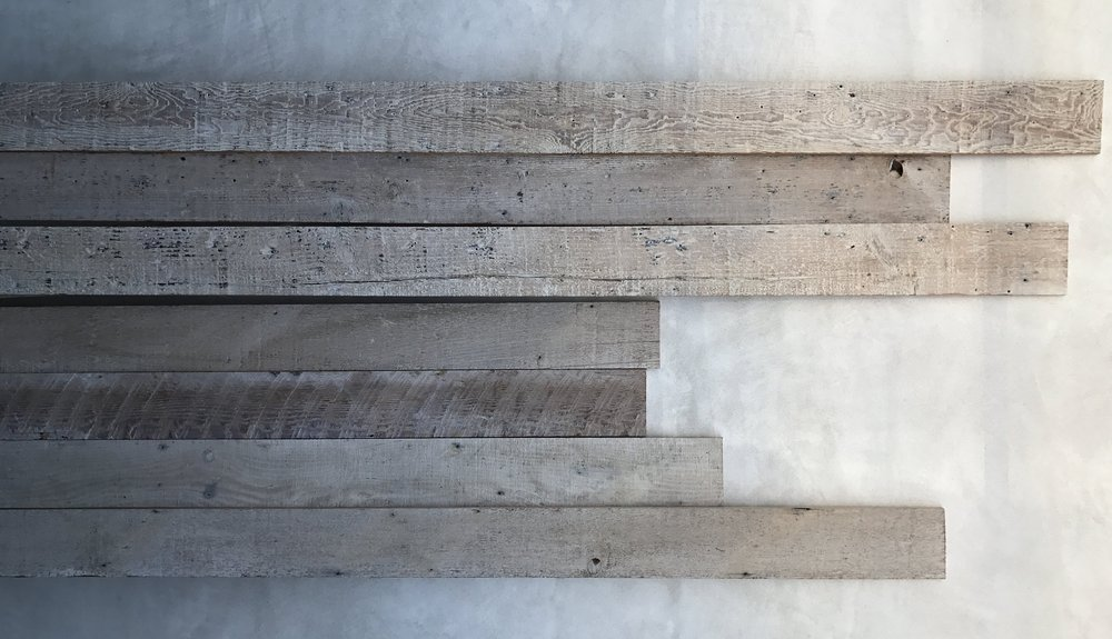 Materials On-Site, Reclaimed Wood on Smooth White Stucco