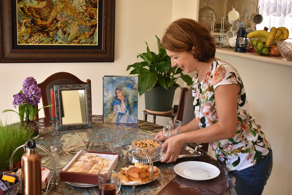 Laden preparing the table to enjoy her Mahii Shekam Pour