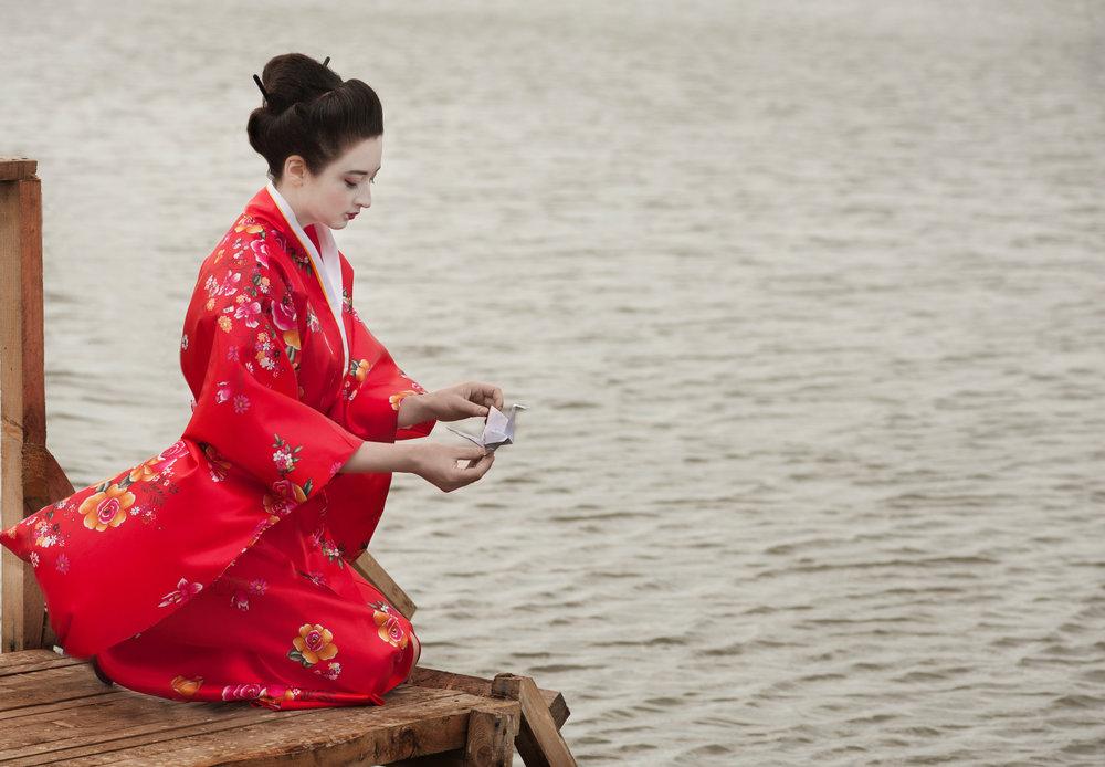 Geisha launches origami bird