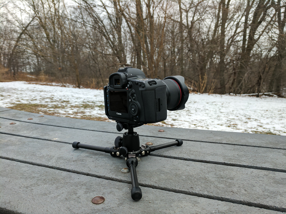 Tripod legs splayed flat on the ground