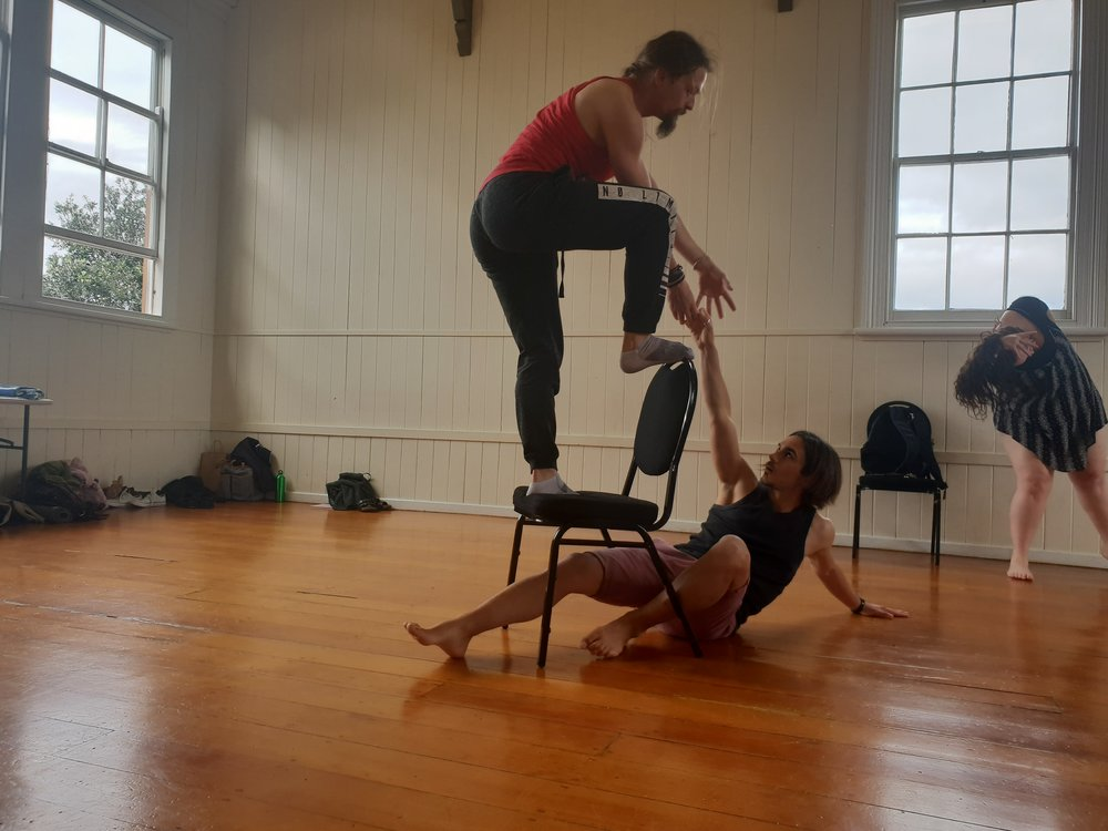 Two of our devising session participants using architecture and improvisational movement.