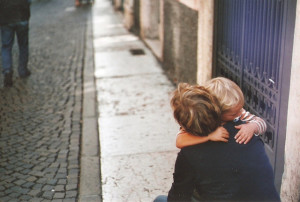 child embracing nanny