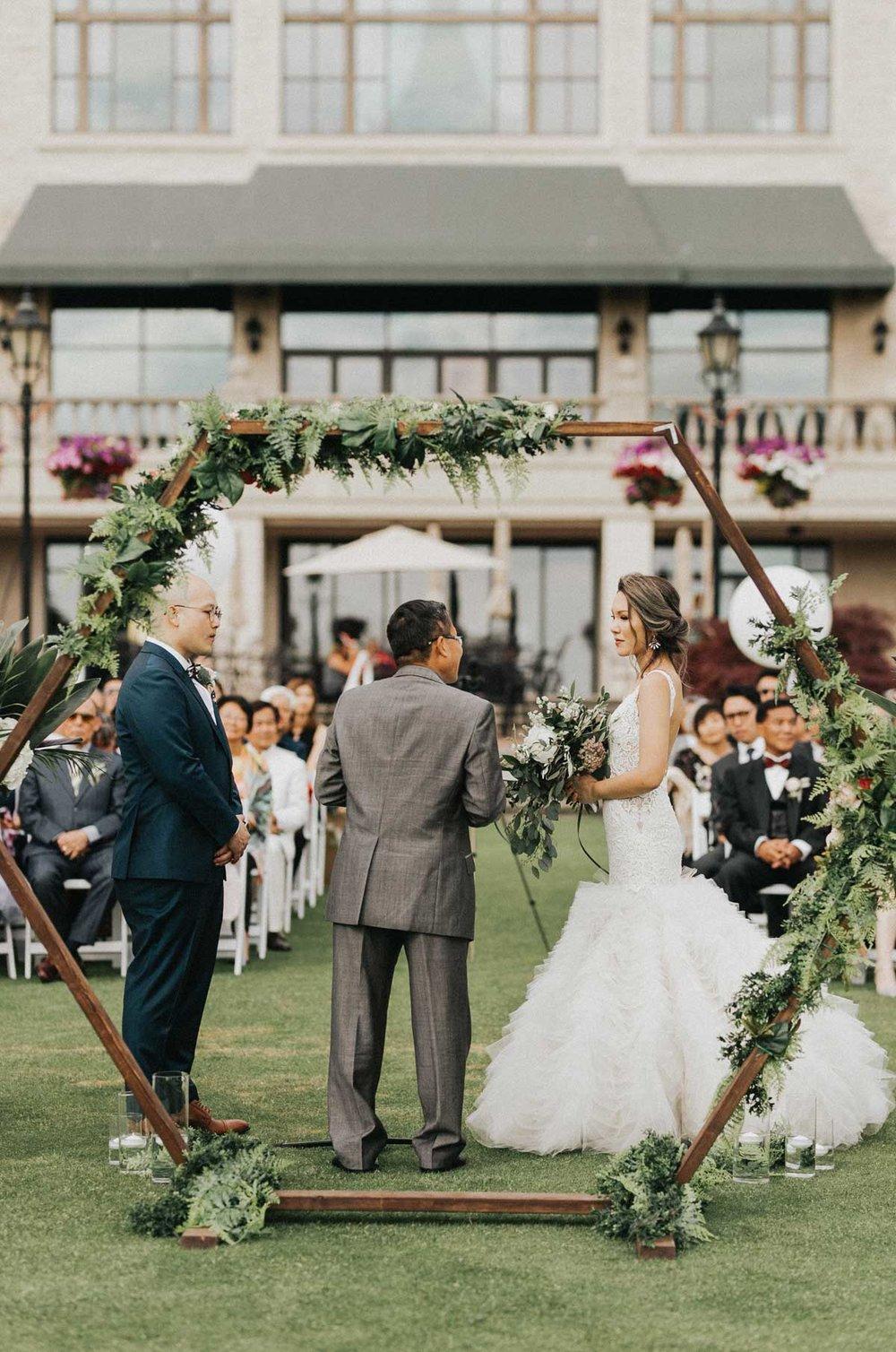 swaneset_flower_arch_wedding_ceremony.jpg