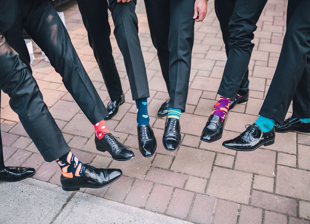 dloveaffair_wedding_sockgame_strong_groomsmen.jpg