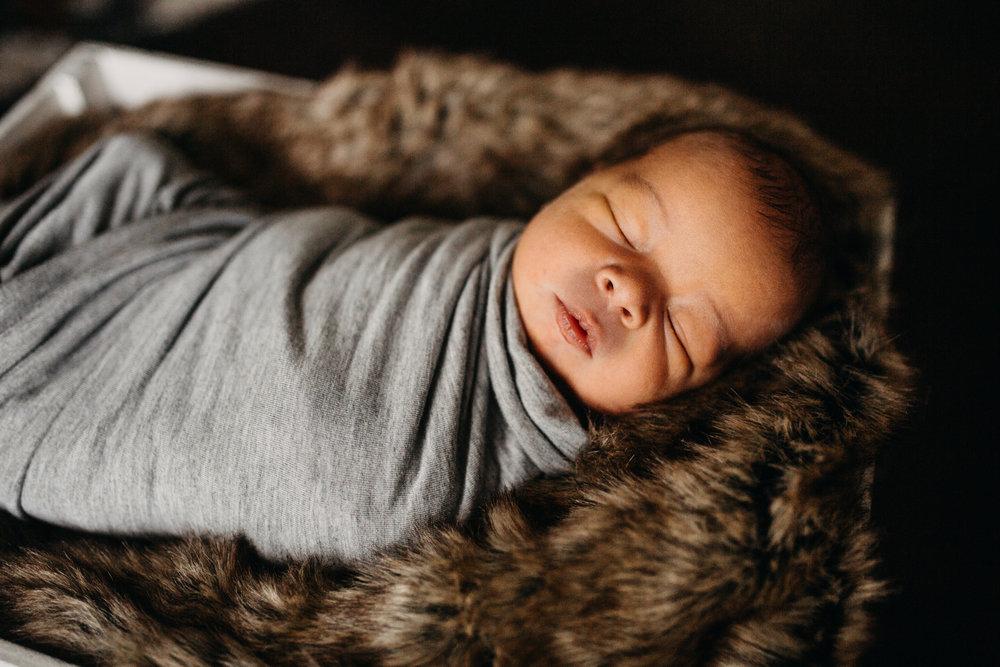 find a newborn photographer