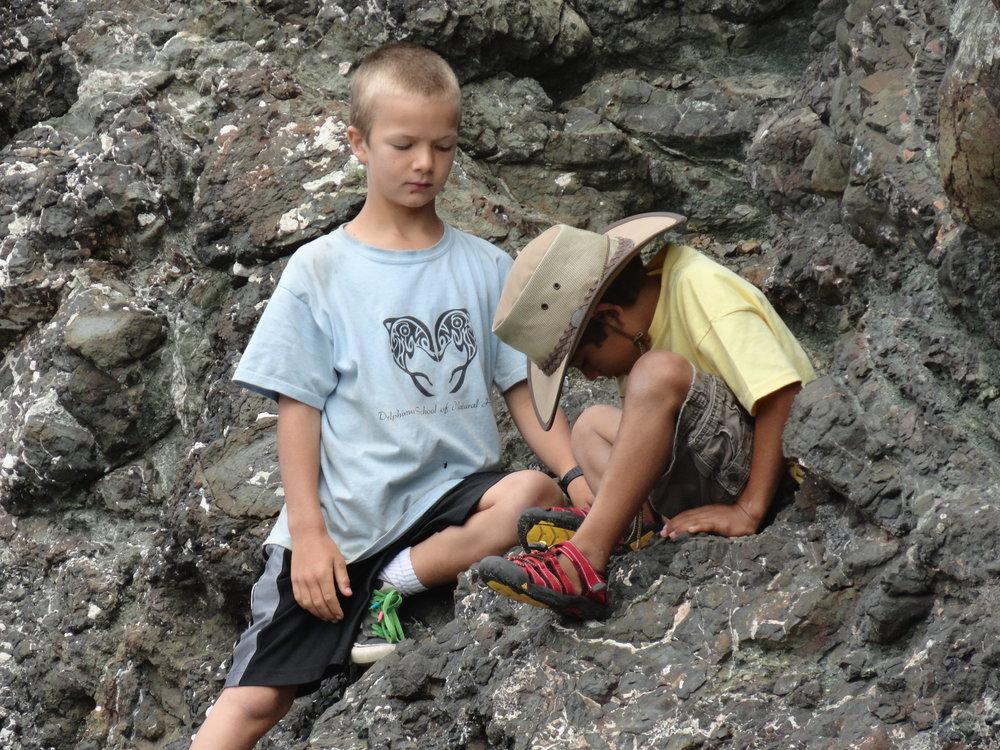 Examining uplifted rock formations formed on the ocean floor.