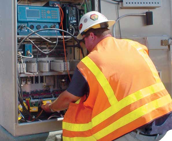 traffic-signal-technician-working-on-intersection-control-cabinet.jpg