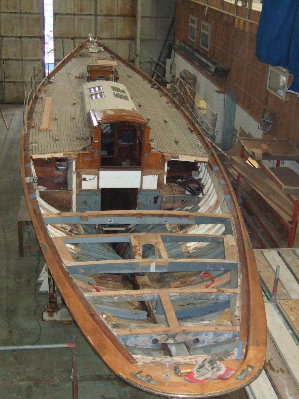 Mylne yacht Kelpie under restoration at Fairlie Yachts