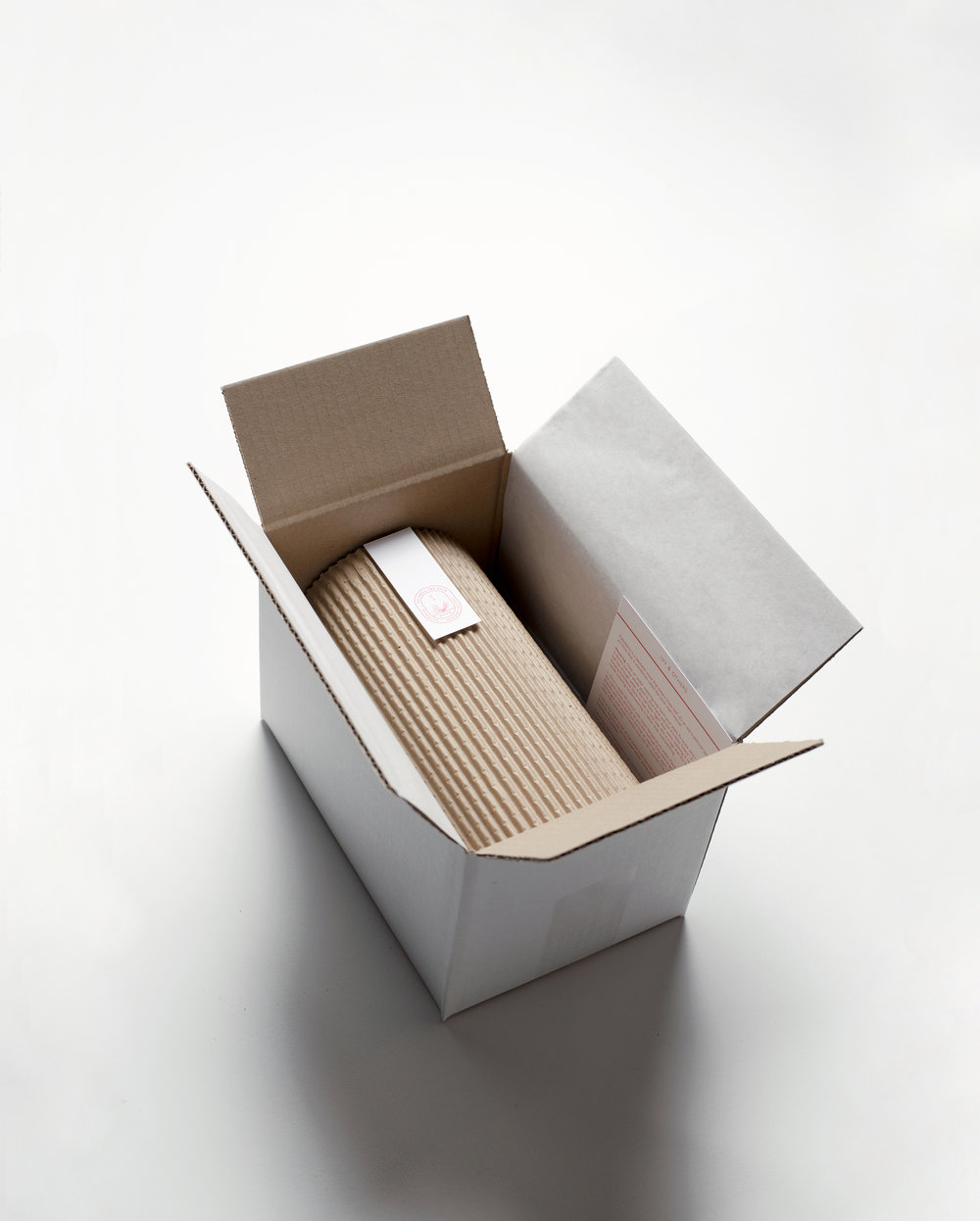 Online store packaging. All Kokedama were packaged and posted throughout Europe with a plant specific care card.