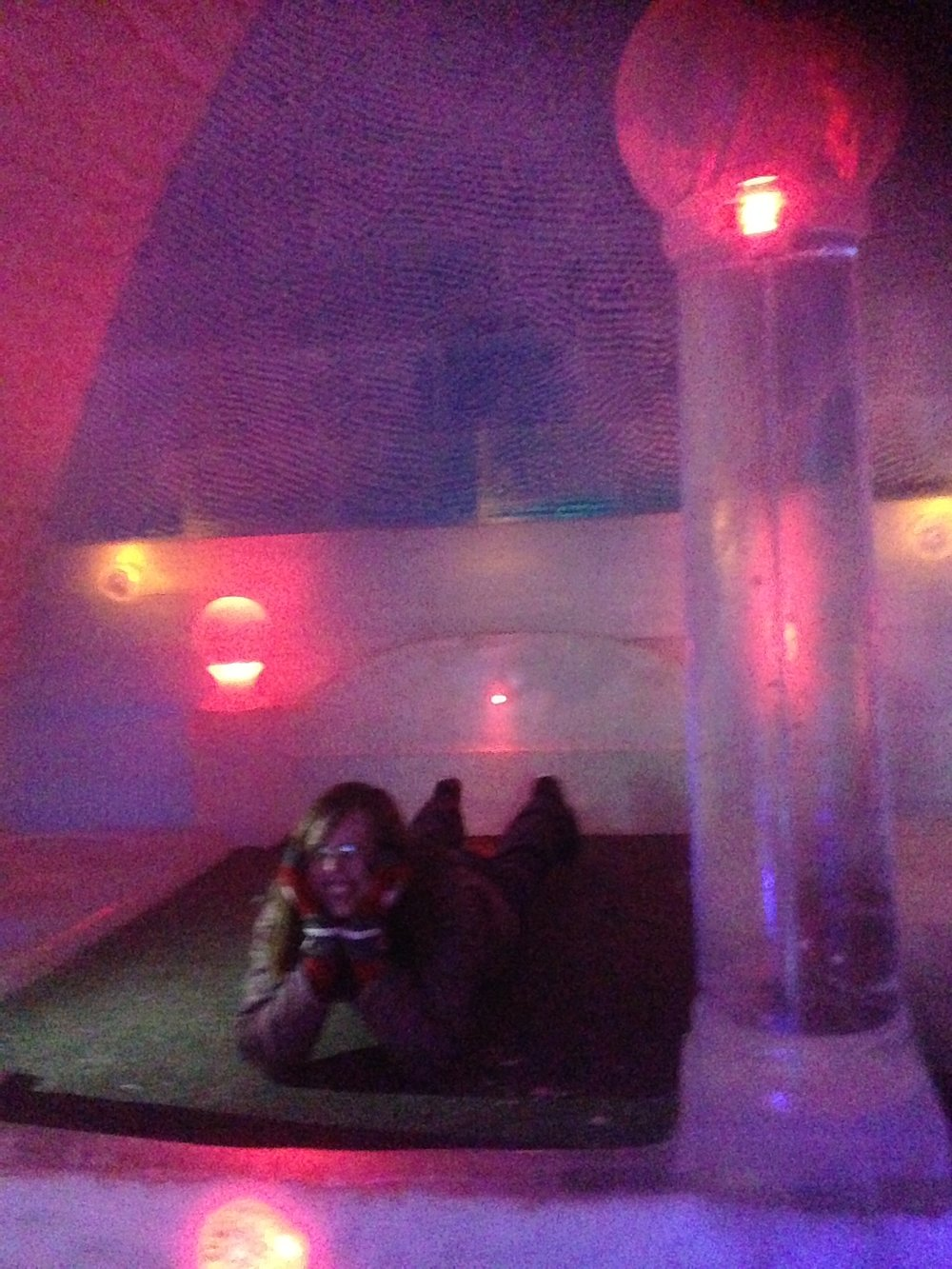 Amanda laying on an ice bed