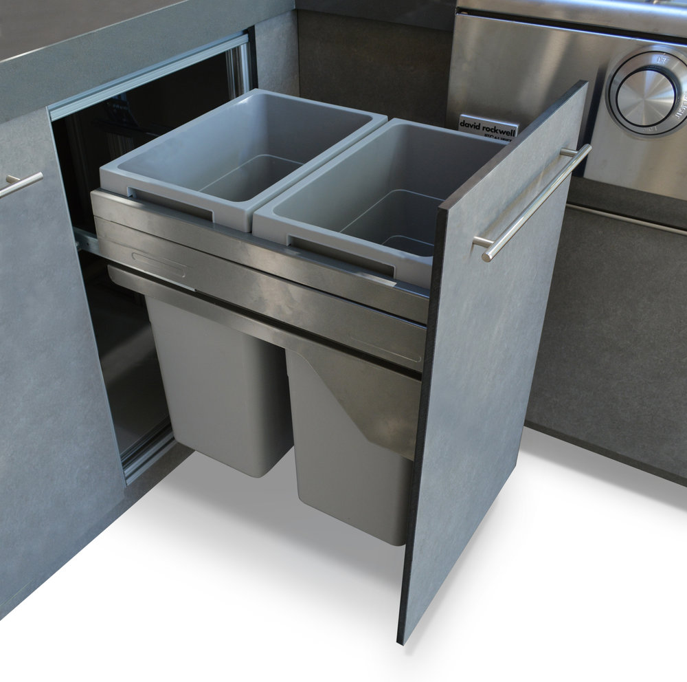 Pull out waste bin for outdoor kitchen cabinetry