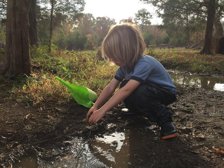 playing in creek w bucket.jpg