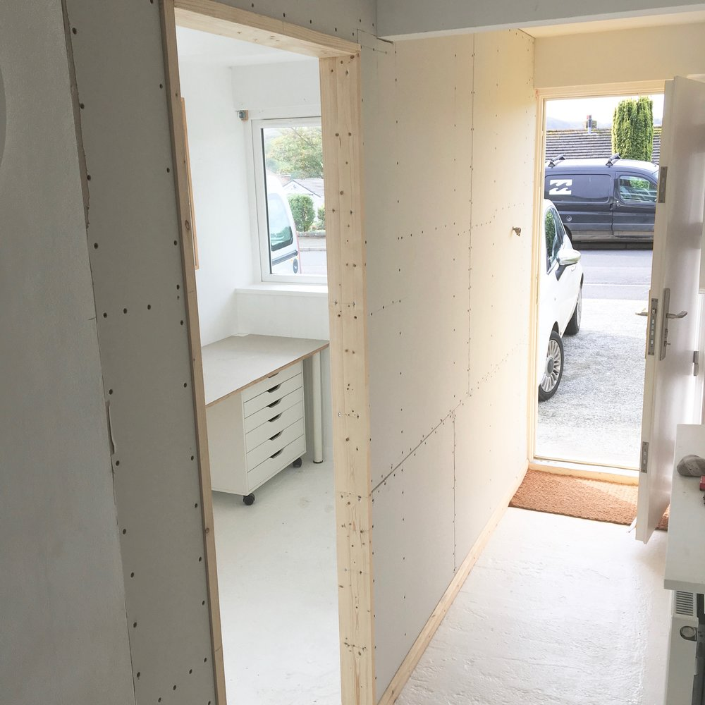 Plaster board and new door frame added.