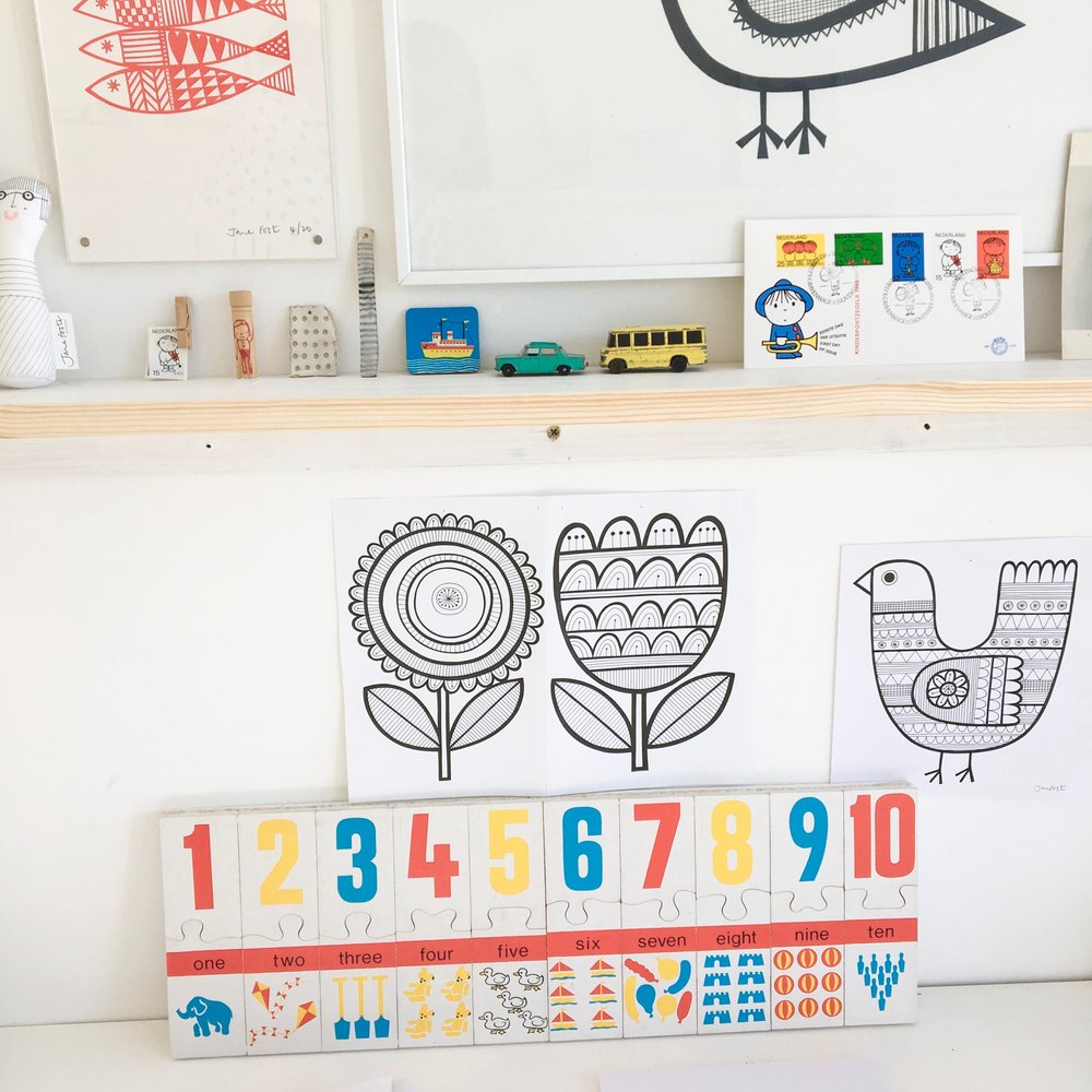 A vintage wooden number puzzle mounted onto board  - to add some colour to my black and white illustrations.