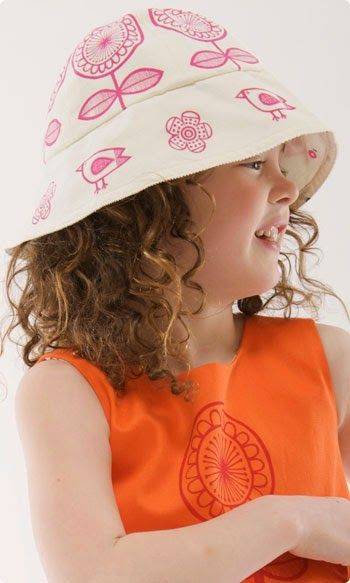 My designs screen printed onto children's pinafore dresses.