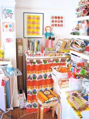 A very poor quality snap shot of my studio at this time in our spare bedroom.Shelves full of my fabric collections!