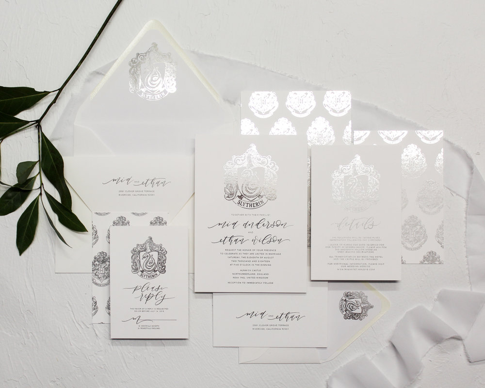 Slytherin Crest - With a full flat silver foil finish, this invitation suite showcases a unique hand-drawn Slytherin Crest. Show off your house pride in an elegant and traditional fashion.Get it duplexed for the patterned backer with the Hogwarts CrestPair it with gree silk ribbon to complete the House colors.