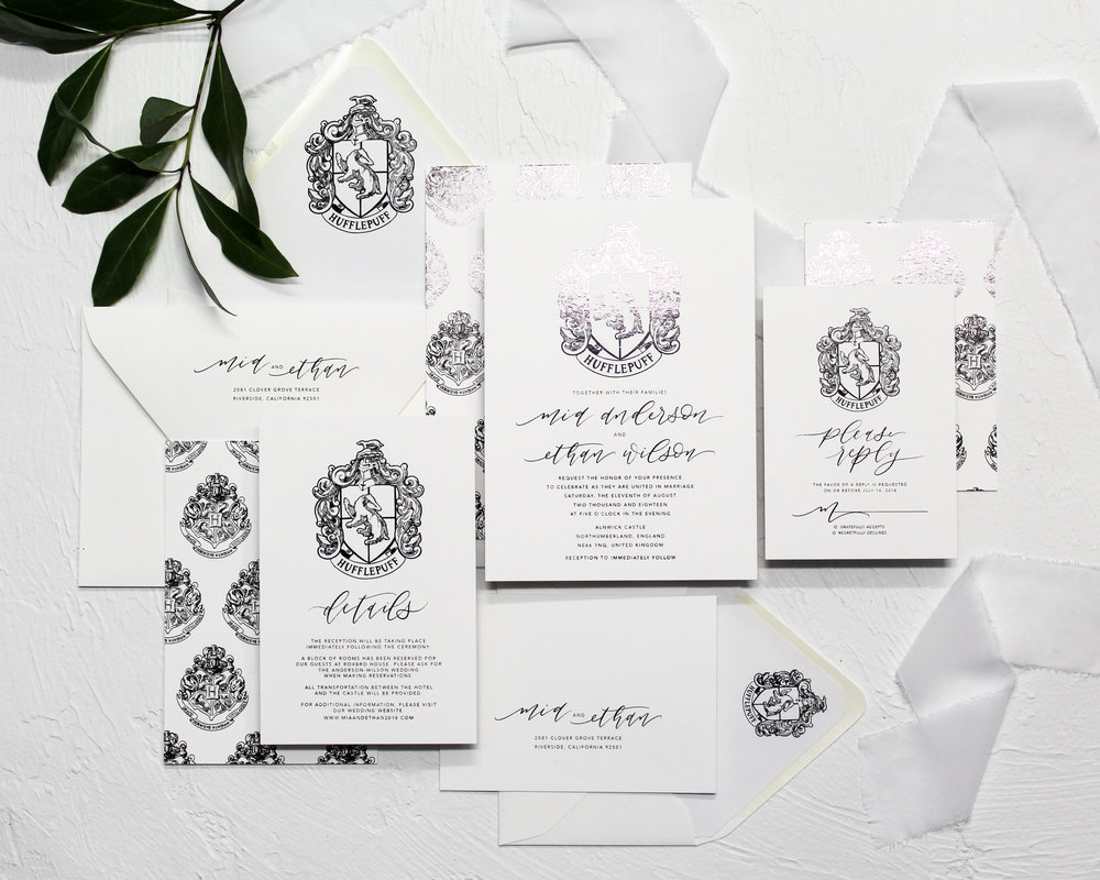 Hufflepuff Crest - With a full flat black foil finish, this invitation suite showcases a unique hand-drawn Hufflepuff Crest. Show off your house pride in an elegant and traditional fashion.Get it duplexed for the patterned backer with the Hogwarts Crest.Pair it with yellow silk ribbon to complete the House colors.