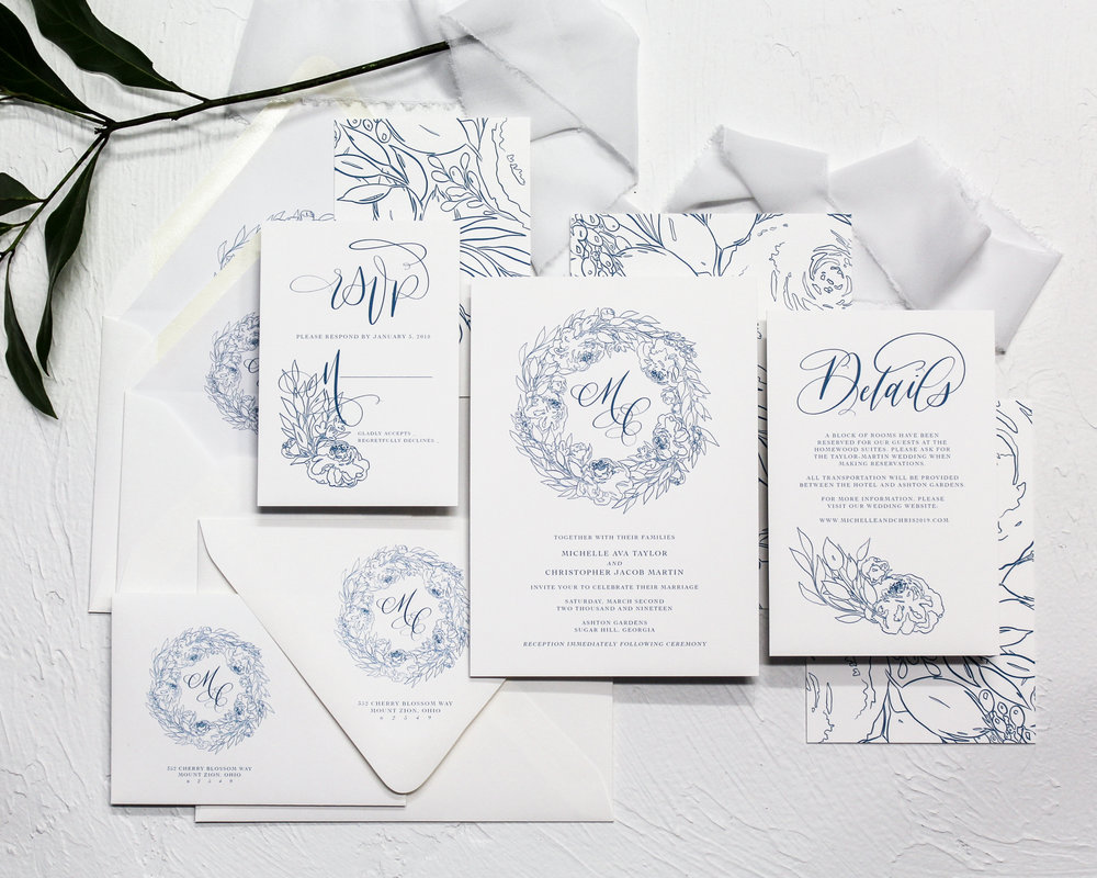 Line Botanicals - Featuring modern line botanicals in a wreath with a custom monogram centered within and paired with a serif font, this suite definitely catches the eye. It's simplistic, yet elegant. Each piece has a line floral illustration from the wreath, and features modern calligraphy.
