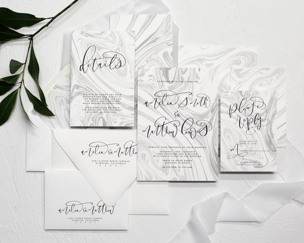 Marbled Ink - A monochromatic theme with truly unique details. The marbled background was originally hand dipped, and is now digitally represented alongside modern calligraphy. Not a fan of the black and white? Switch up the colors to match your theme.