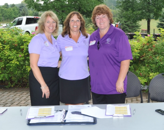 Volunteers Sharon Simmonds, Janet Morgan and Sharon McDermott, looking pretty in purple!
