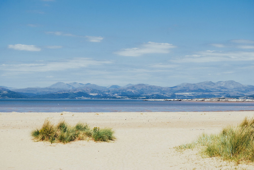 The beach to the north of Walney Island, looking over the Duddon Channel.With the old iron works slag heap to the right and towards the National Park in the distance.
