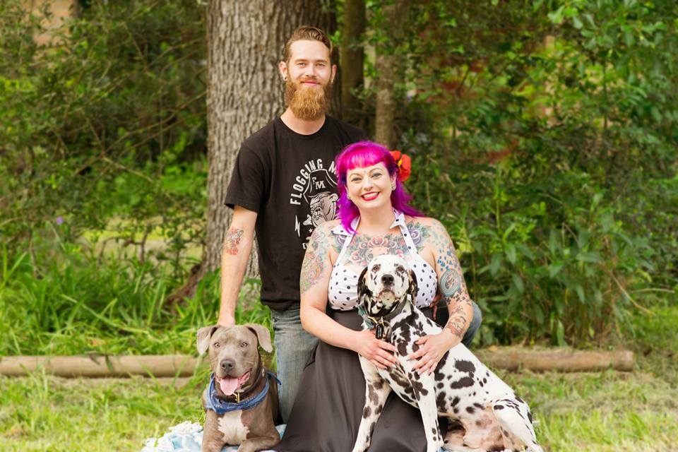 Brett, Natalie, and two of their proud puppers. Photo by Angie Guerra.