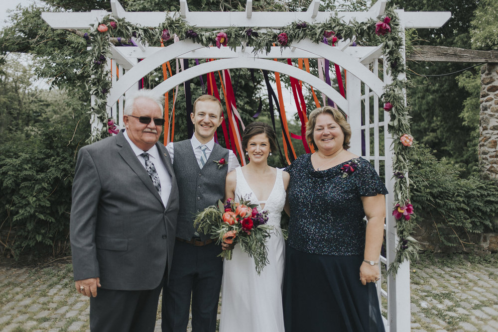 We love Darian's vision for this arbor. The bright colored ribbon and the garland compliment each other nicely and create a beautiful backdrop for the ceremony.