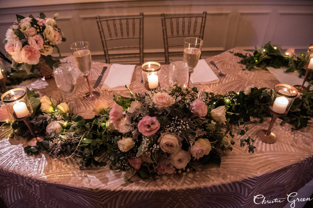A garland for the sweetheart table is the perfect touch of extra décor to set the couple apart.
