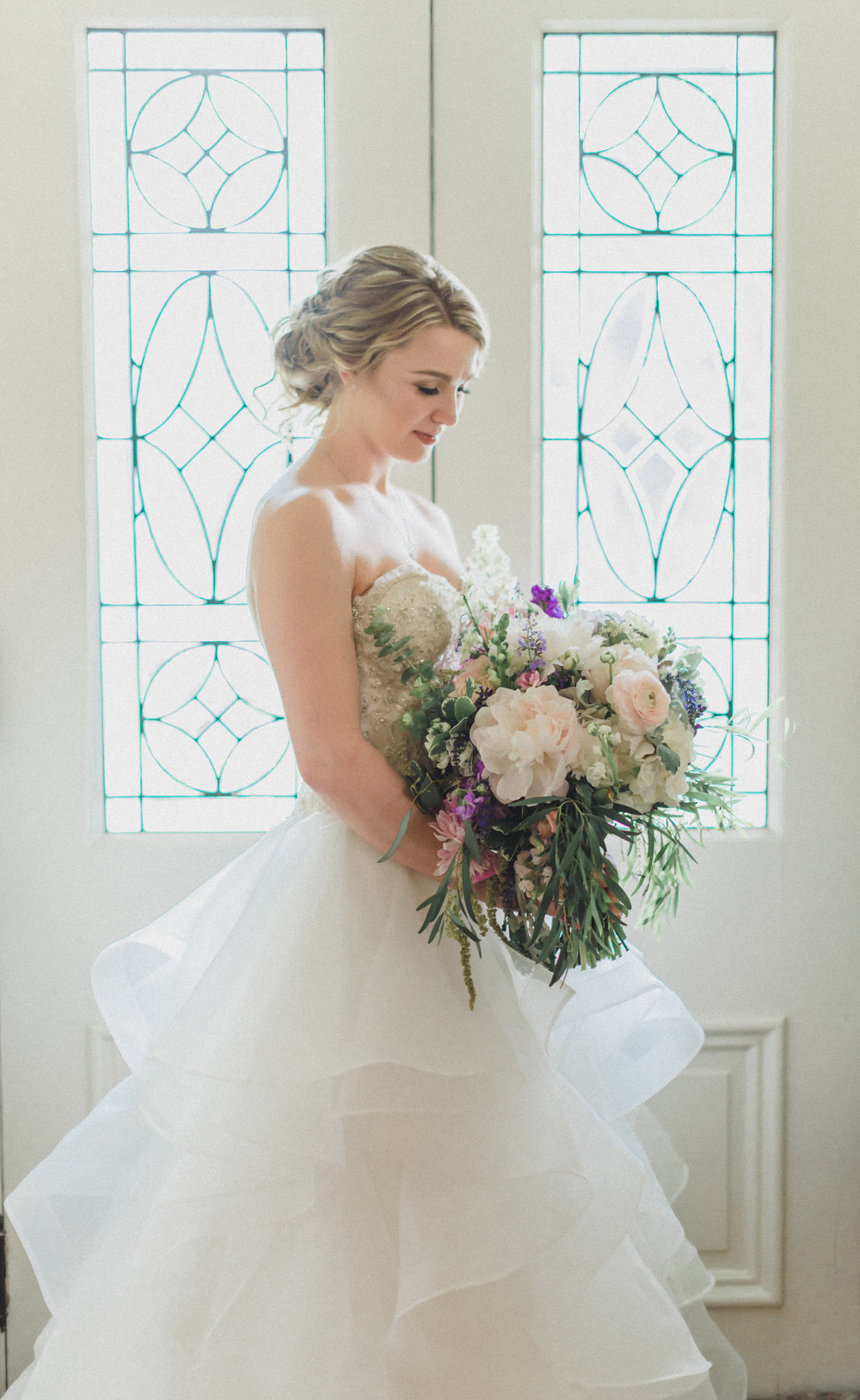 The beautiful bride and her lush bouquet full of summer favorites including peonies, snap dragon, ranunculus, stock, hydrangea, willow eucalyptus, dusty miller, pittosporum, and hanging amaranths- to name a few!