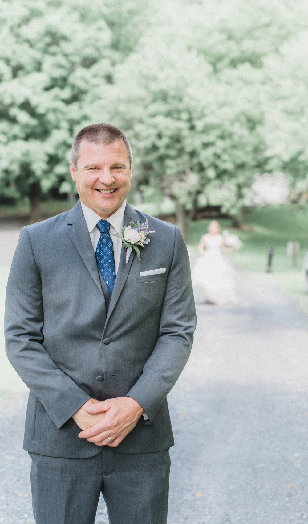 This grinning father proudly wears his peony bud boutonniere as he waits for his father-daughter first look! A really fun and special moment to include in your day.