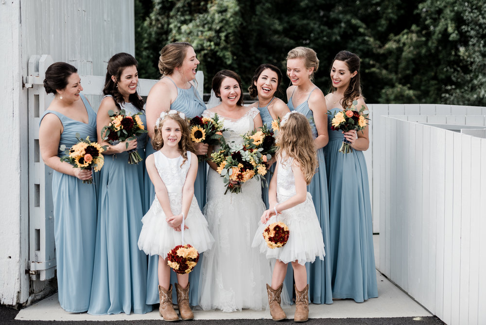 These flower girl pom poms are made out of fresh mums and are just the cutest carried by these girls down the aisle.