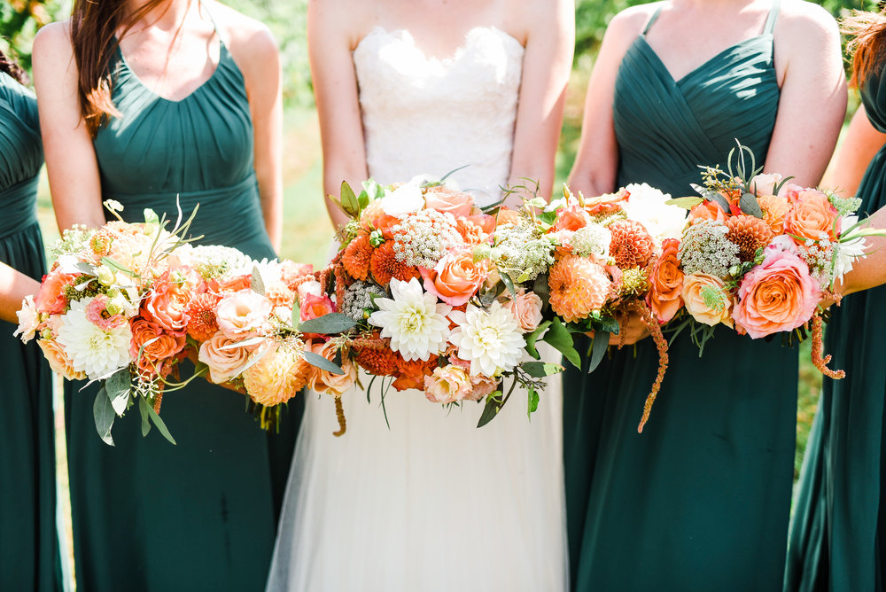 The bouquets in all their warm pallet glory! Big roses, dahlias, and lisianthus carry the central elements of the girl's bouquets with queen annes lace, hanging amaranthus, and seeded eucalyptus complimenting perfectly.