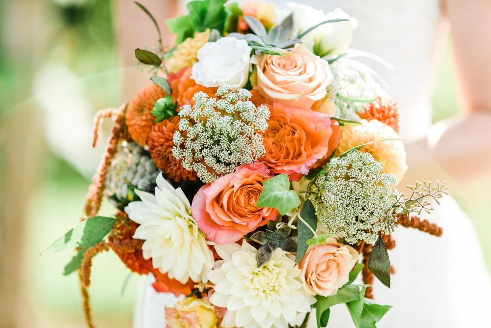 We love the little succulents peeking through Heather's bouquet! They always add the sweetest touch in any season!