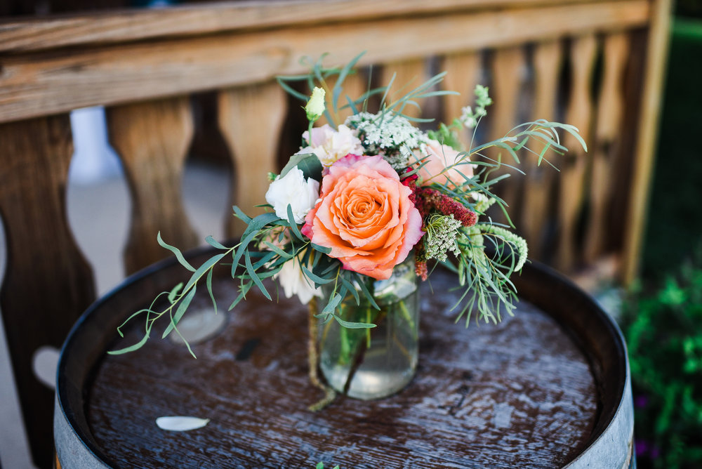 Mason Jars are just the right size for accent arrangements among the reception or ceremony decor. They are so simple and always tasteful.