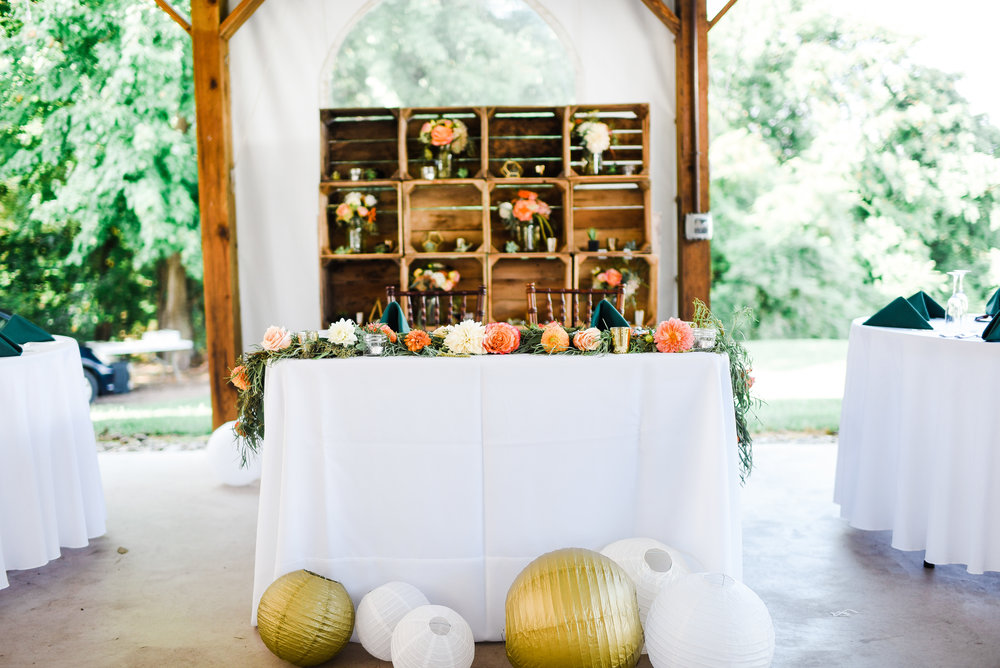 We just love the creativity on display here with the backdrop to Heather and David's sweetheart table. Bridesmaid bouquets can always double as centerpieces or accent decor for the reception! And of course, we are ever in favor of a colorful garland to adorn the Bride and Groom's table.
