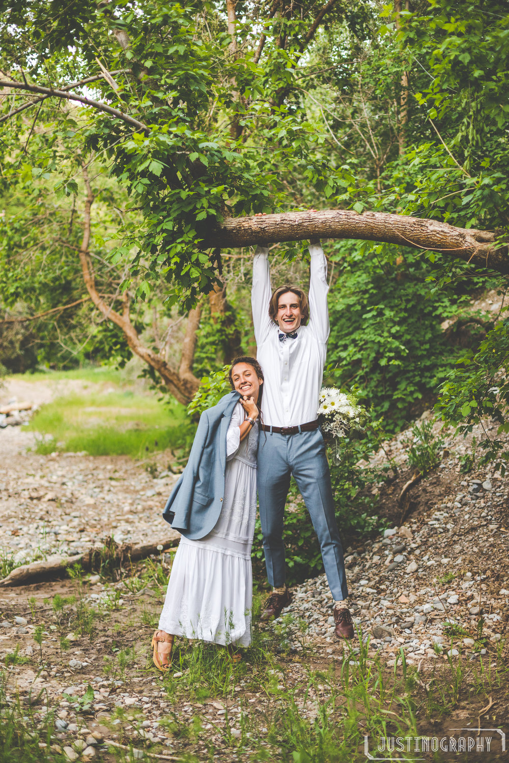 "This was the closest to a ""rock climbing"" photo we could get in wedding attire. :)"