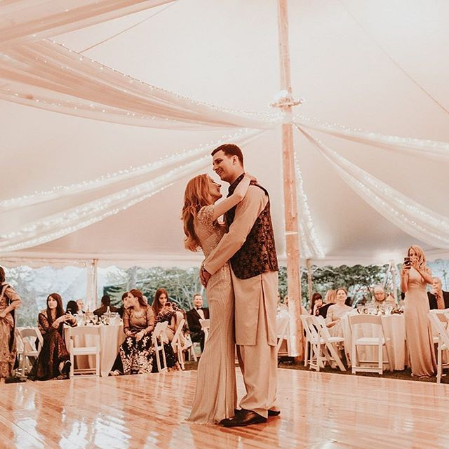 """Your first dance as a married couple. The pressure, all eyes on y'all! Ha, it shouldn't be that nerve wrecking. I have a lot of couples ask for suggestions about first dance songs, many of whom are wondering what's """"standard"""". Who cares what's """"standard."""" Choose a song that's special to y'all, even if it's not a slow one or if everyone before you chose the same. Make up your own dance moves and have fun with it!⠀ .⠀ .⠀ planning: @mksocialco photo: @rachelleinerphotography tent/lighting: @newporttent⠀ .⠀ .⠀ #firstdance #getjiggywithit #bustamove #slowdance #canihavethisdance #loveauthentic #lovebirds #justmarried #mrandmrs #sailclothtent #bostonbrides #eastcoastwedding #backyardwedding #destinationwedding #weddingstyle #weddingdetails #weddingphotography #weddingplanner #destinationweddingplanner"""