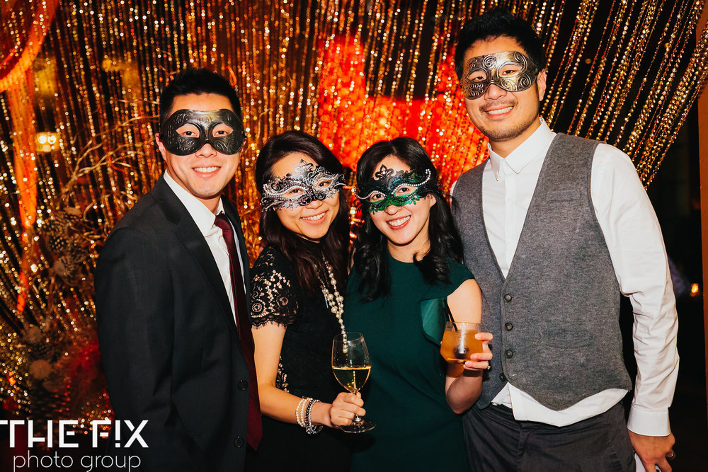 Corporate holiday party entertainment at Herban Feast , photographed by the Fix Photo Group