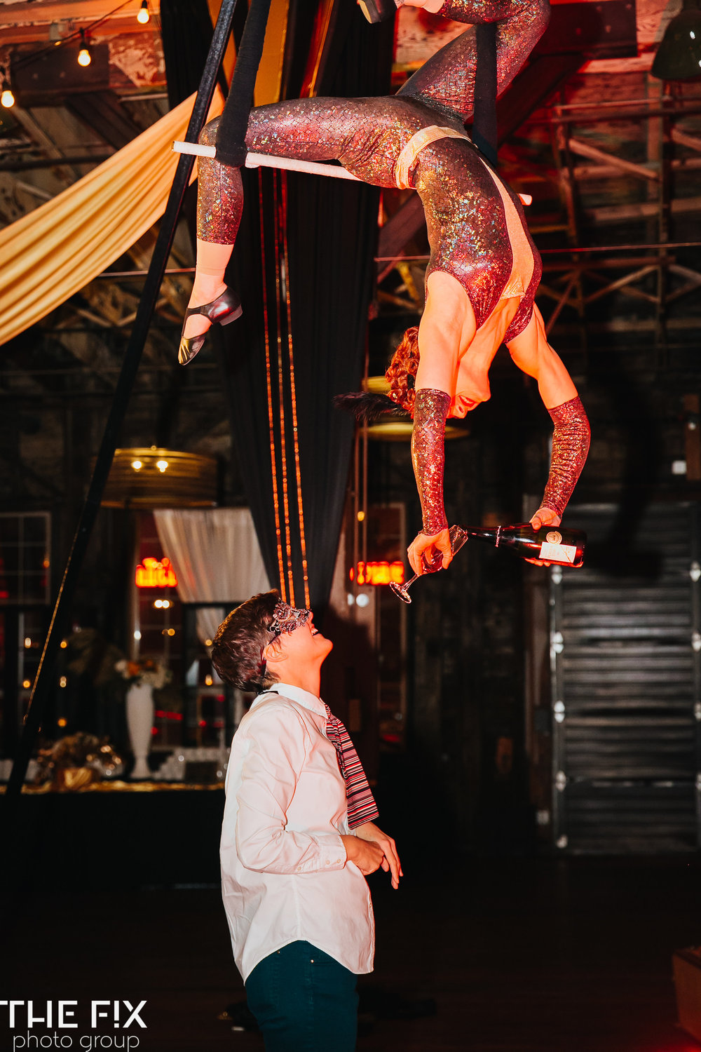 aerialists at a   Corporate holiday party entertainment at Herban Feast , photographed by the Fix Photo Group